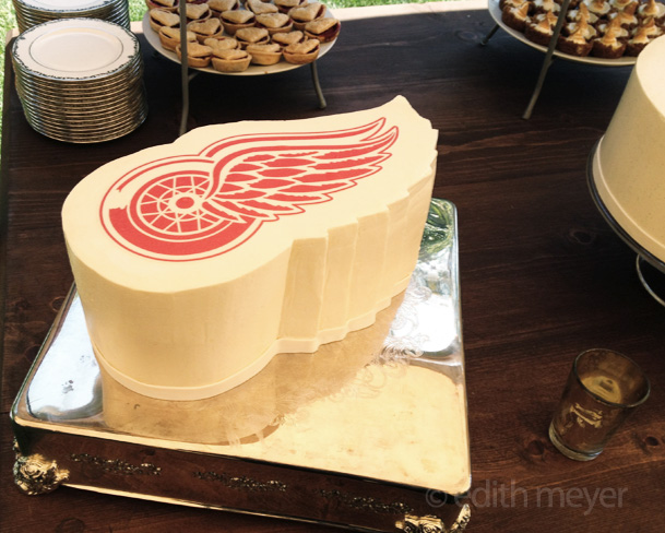 Cake shaped like Red Wings logo